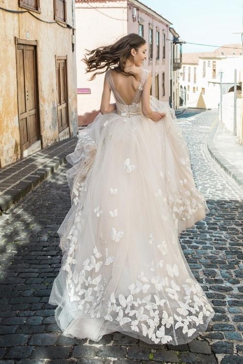 Robe de mariée papillons